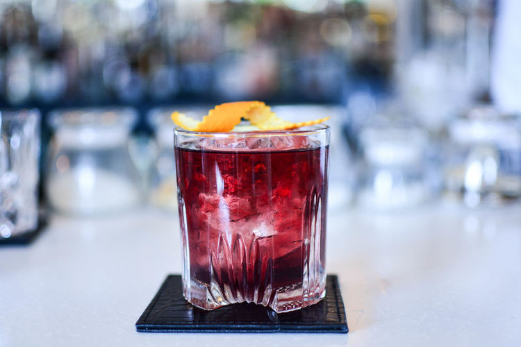 Close-Up Of Drink On Counter In Bar