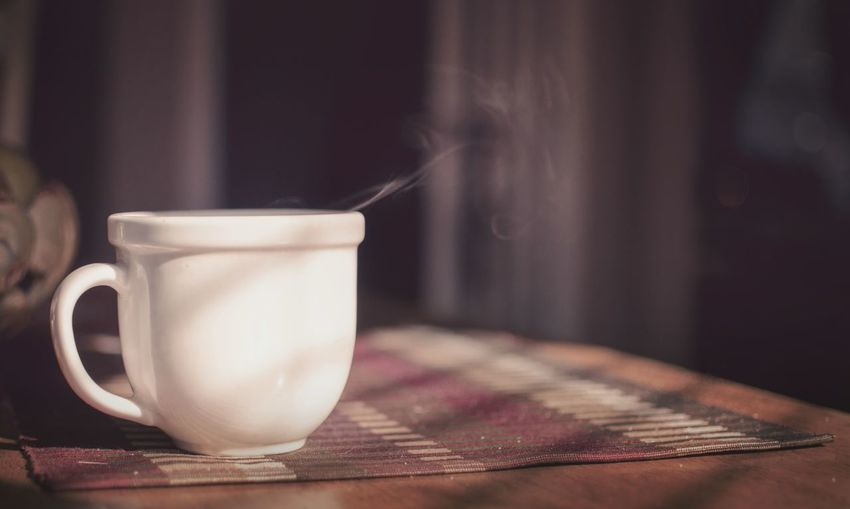 Close-up of hot tea cup on table