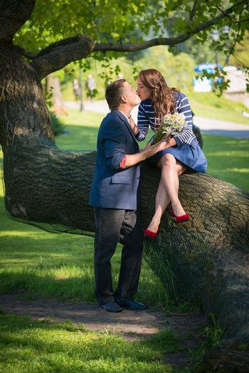 Man and woman kissing at park