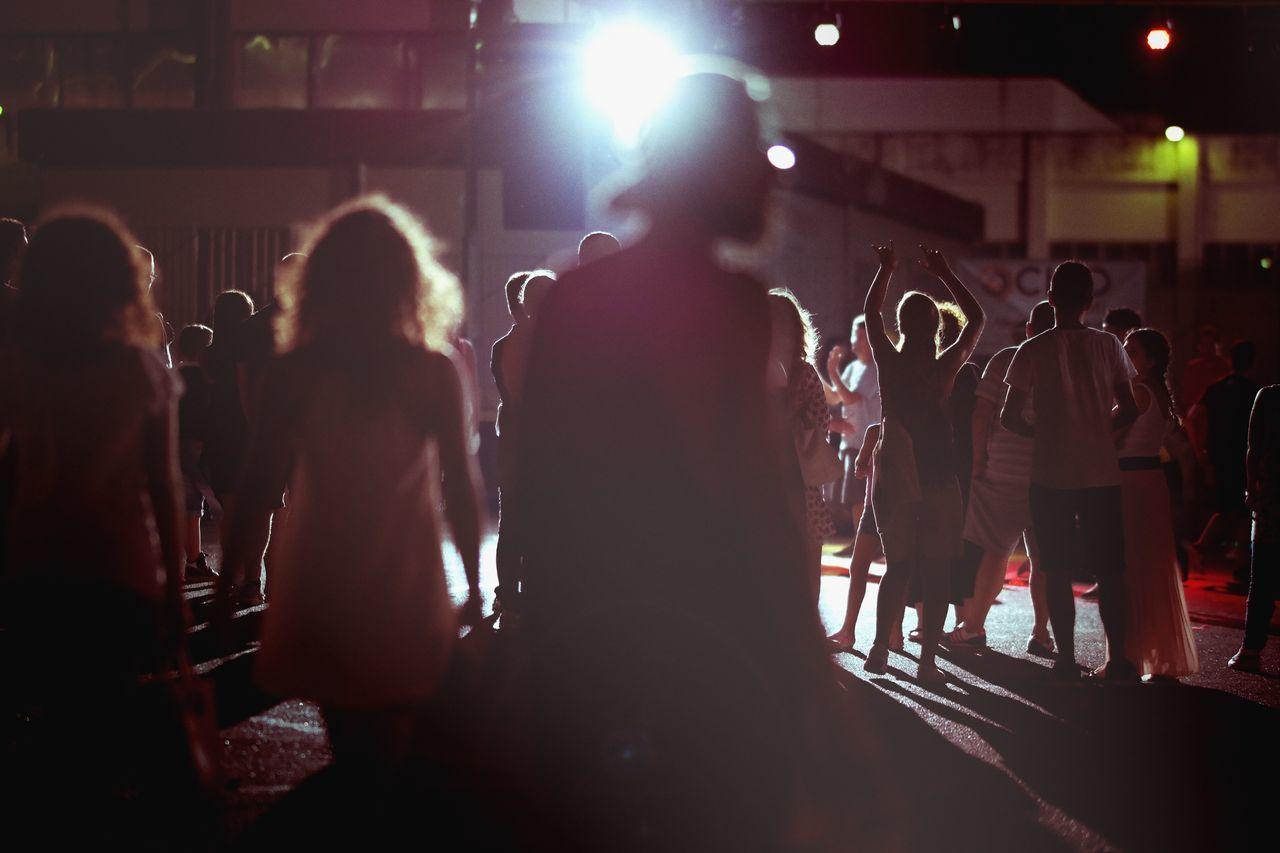 People enjoying at street at night