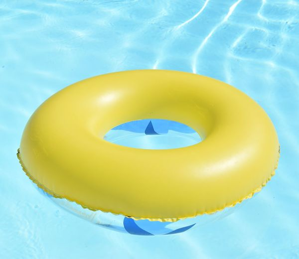 High angle view of yellow floating in swimming pool