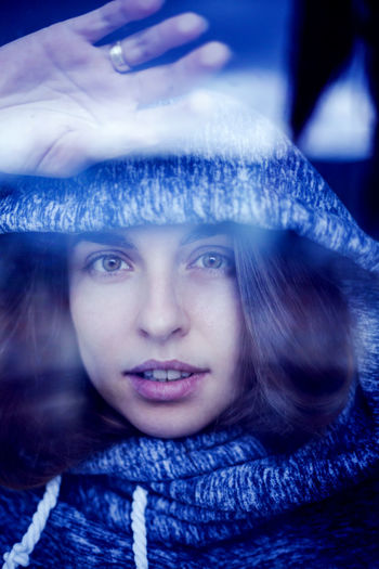 Close-up portrait of a young woman in winter