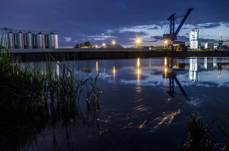 Architecture Building Exterior Built Structure Cloud - Sky Crane - Construction Machinery Dusk Fuel And Power Generation Illuminated Industry Lake Nature Night No People Outdoors Plant Reflection Sky Sunset Water