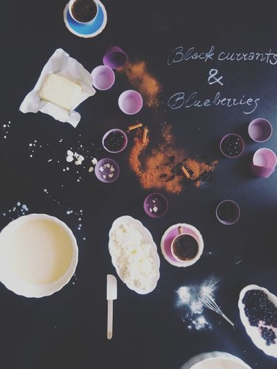 Pastel Purple Muffin Cups Cupcakes Black Background Black Currants Blueberries Table Situation Flat Lay Ingredients Butter Cinnamon Rolls Cinnamon Forest Fruits Baking Cookies Baking Cup Of Coffee Kitchen Tools Mixing Bowl Cottage Cheese