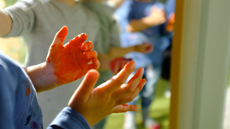 CREATORS Hand Human Hand Human Body Part Focus On Foreground Holding Indoors  Close-up Day Painting Fingerpainting Education Fun Colorful Colors Childhood Two People Child Selective Focus Unrecognizable Person Leisure Activity Moms & Dads