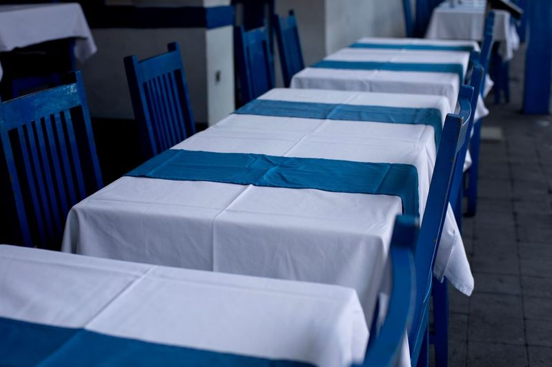Empty tables, greek restaurant, Seminyak, Bali Eyemphotography Eyem Best Shots Eyem Collection Seminyak Bali Restaurant Scene Blue Color In A Row Seat Blue No People Indoors  Chair Absence Repetition Table Large Group Of Objects Arrangement White Color