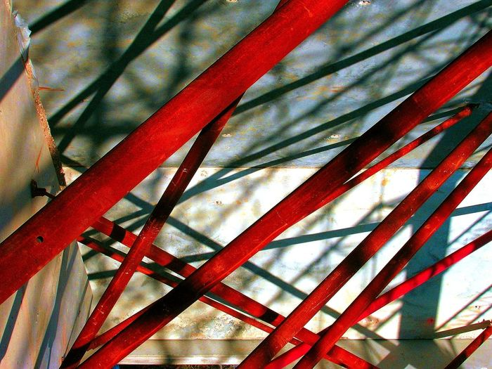 RED CHAOS ARCHITECTURAL BRACES Architectural Patterns Abstract Photo CONCRETE WALL SUPPORTS CONSTRUCTION SUPPOORTS Cool Cool Shot! METAL SUPPORTS METAL WALL SUPPORTS Shadows Metal Pattern Red Red Color