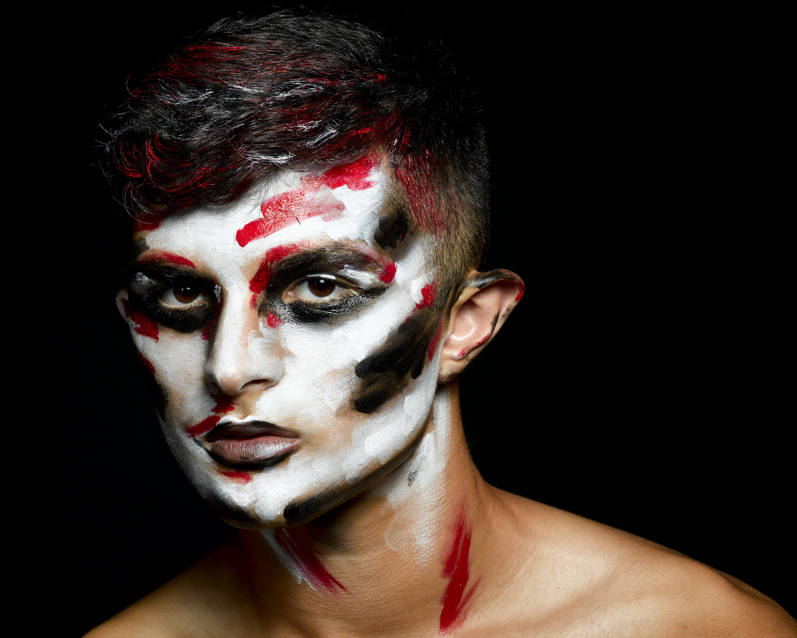 portrait, black background, make-up, studio shot, headshot, looking at camera, one person, halloween, indoors, young adult, paint, face paint, horror, celebration, spooky, fear, stage make-up, copy space, costume, human face, body part, evil, dark, body paint