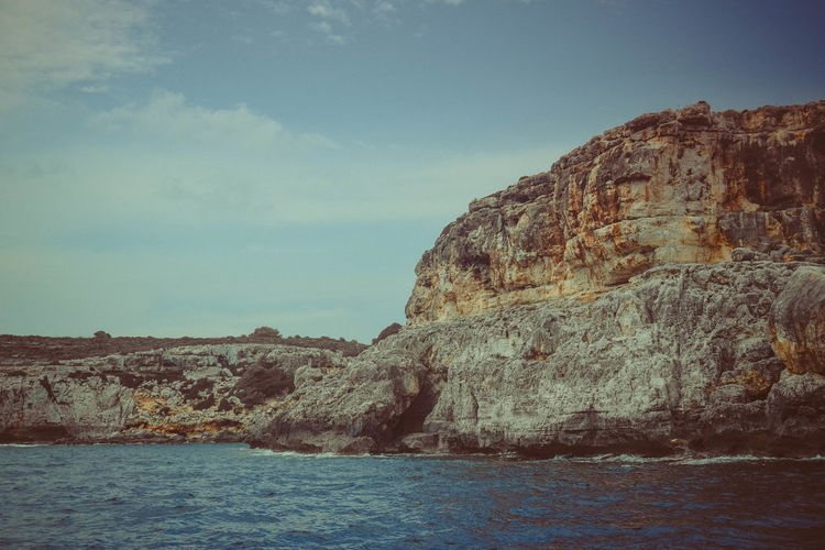 Sky Scenics - Nature Beauty In Nature Tranquility Tranquil Scene Nature Outdoors Seascape Landscape Rocks Geology Sea Water Rock Cliff Land Travel Environment Scenery Beach Freedom Marine