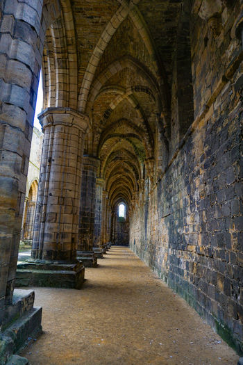 Kirkstall Abbey in Leeds, West Yorkshire, England Architecture Arch The Past Built Structure History Arcade Building Direction Old Indoors  No People The Way Forward Travel Destinations Corridor Diminishing Perspective Wall Day Ancient Brick Architectural Column Abbey Ruins Historic Abbey Church Ancient Leeds Uk
