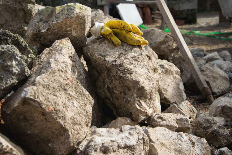 Close-up of gardening glove on rock