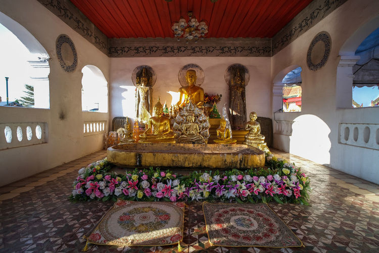 View of buddha statue in courtyard of building