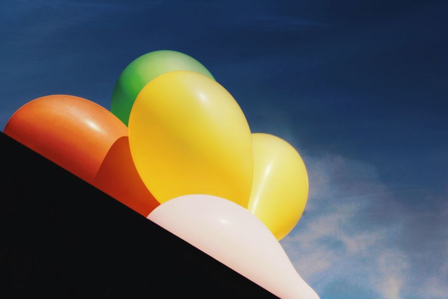 Balloons Colorful Pop Vibrant Balloon Sky Yellow No People Low Angle View Multi Colored Nature Helium Balloon Outdoors Blue Day Fragility Orange Color Cloud - Sky Celebration Close-up Mid-air Sunlight Vulnerability  Inflatable