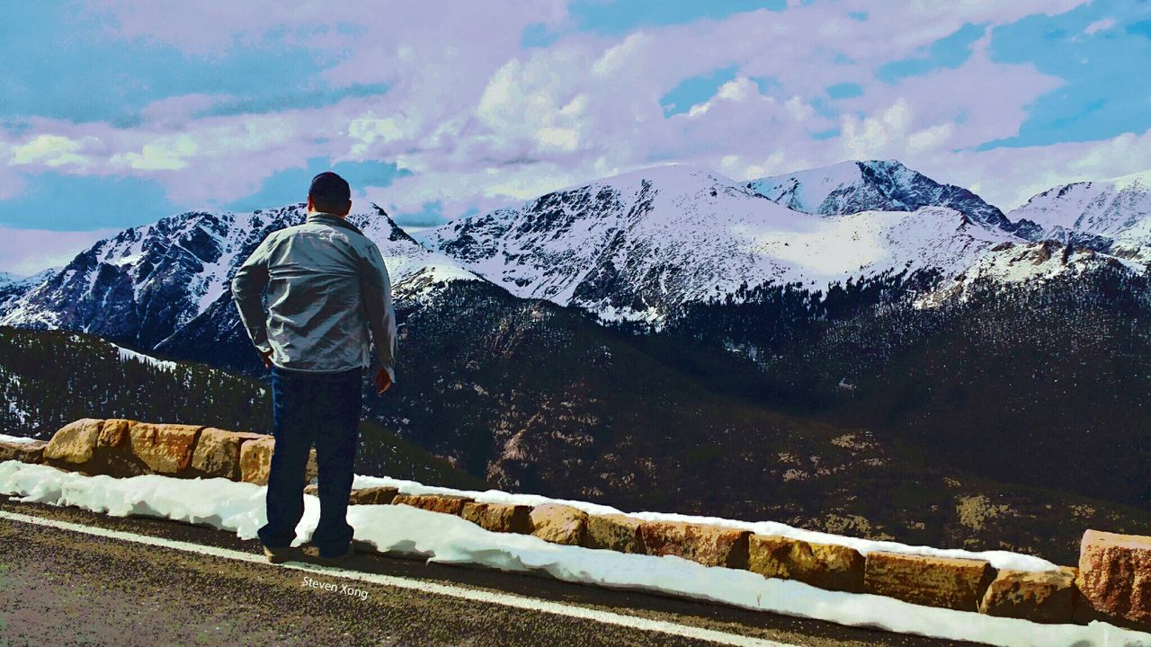 snow, mountain, rear view, winter, real people, cold temperature, standing, one person, full length, nature, men, scenics, backpack, beauty in nature, day, sky, leisure activity, outdoors, casual clothing, mountain range, adventure, landscape, snowcapped mountain, lifestyles, adult, people