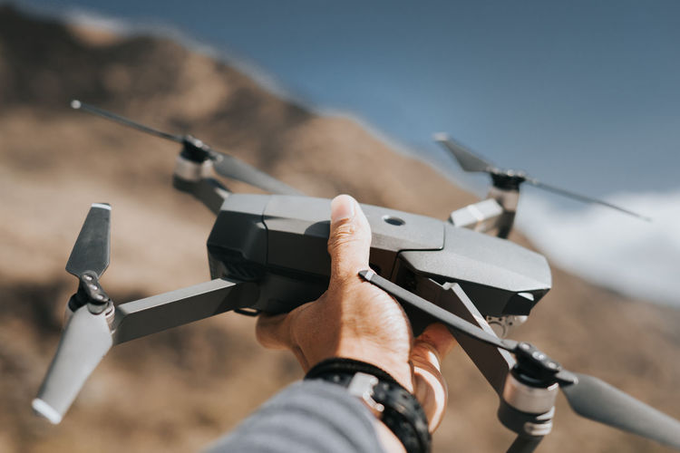 Close-up of hand holding drone