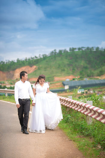 Adult Adults Only Bride Bridegroom Celebration Day Flower Happiness Husband Men Only Men Outdoors People Smiling Togetherness Two People Wedding Wedding Dress Wife Women Young Adult