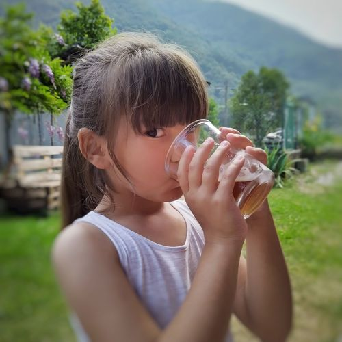 Portrait of girl drinking drink