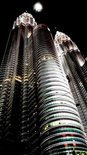 When the night sky was so clear that the moon shines brightly above the twin towers. Klcc Twintowers Kualalumpur Malaysia'spride