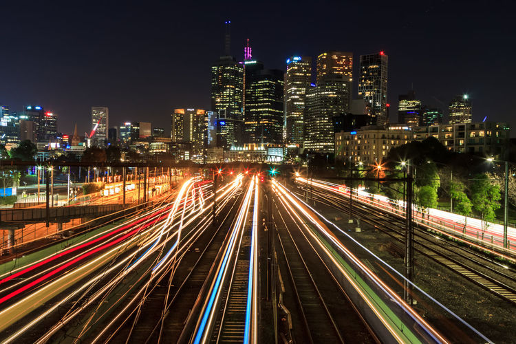 Train light trails leading into the CBD Architecture Building Building Exterior Built Structure City City Life Cityscape Glowing High Angle View Illuminated Light Trail Long Exposure Modern Motion Nature Night No People Office Building Exterior Outdoors Sky Skyscraper Speed Track Transportation Urban Skyline