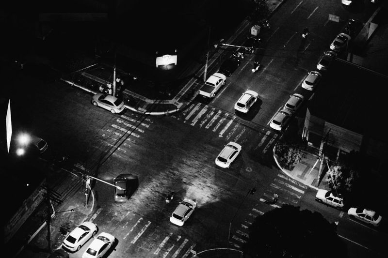 High angle view of vehicles on road in city