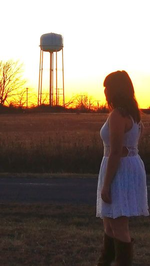 Teen observing the Sunset by the Water Tower in Oklahoma Teen Teenager Teenage Girls Model Sunset Silhouettes Country Living Country Life Sunsets Oklahoma OklahomaSkies Beautiful Day Sunset_collection Beautiful Beautiful People Beautiful Girl Fashion Stories Sunset Rear View Child Girls Childhood People Adult Standing Sky Outdoors Nature Young Adult Day
