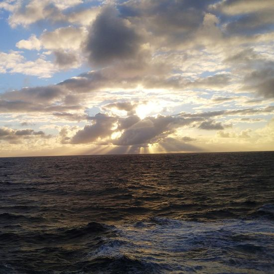 sunshine over the sea and behind a cloud Cloud Waves Rayons De Soleil Life At Sea Vie En Mer Humanatsea Sunshine Sea Sky Water Cloud - Sky Beauty In Nature Horizon Sunset No People Outdoors Tranquility Sunlight Nature