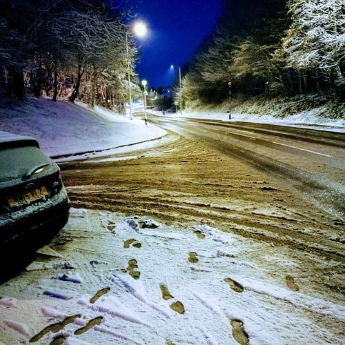 Surface level of road in winter at night