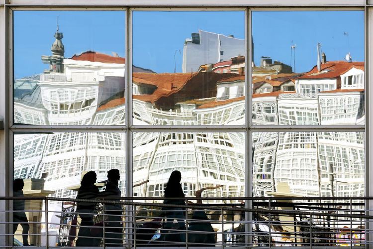 Coruna reflection of glass houses , Spain , Europe A Coruña A Coruña City Galicia Architecture Building Building Exterior Building Reflections Built Structure City Corridor Coruña Galicia Spain Glass Glass - Material Group Of People Real People Street Photography Streetphotography Women