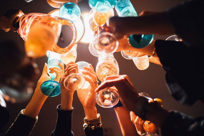 Adult Adults Only Alcohol Audience Beer - Alcohol Celebration Cheering Cheers Close-up Drink Hands Holding Human Body Part Human Hand Indoors  Men New Year's Eve Night Nightlife Party - Social Event People Toast Women Wine Moments