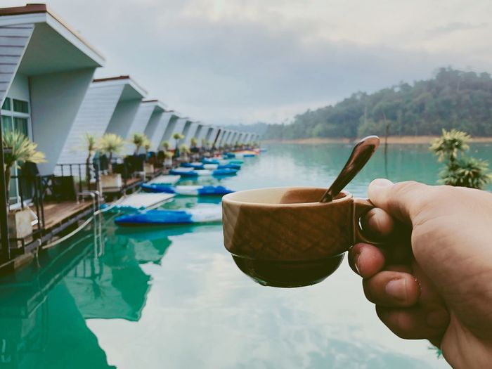 Human Hand Water Holding Hand Food And Drink Real People Human Body Part One Person Cloud - Sky Sky Day Architecture Food Focus On Foreground Nature Lifestyles Built Structure Unrecognizable Person Swimming Pool Outdoors Finger