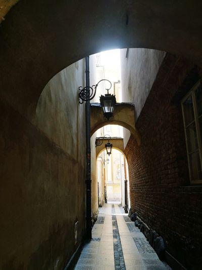 Empty street along walls