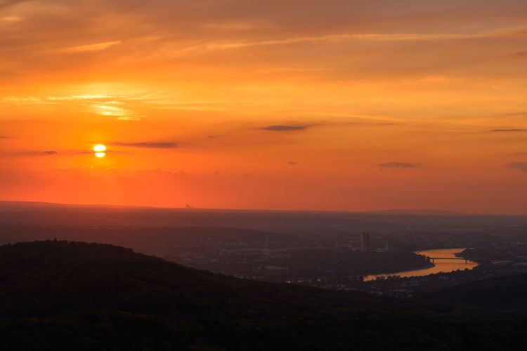 The cityscape of Bonn, next to the Rhine, during sunset. Riverside Architecture Beauty In Nature Building Exterior Built Structure City Cityscape Cloud - Sky Environment High Angle View Horizon Landscape Nature No People Orange Color Outdoors River Romantic Sky Scenics - Nature Sky Sun Sunlight Sunset