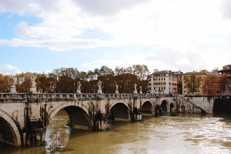 Riverside Rome, Italy Rom Bridge - Man Made Structure Architecture Arch Built Structure Sky Connection Cloud - Sky Water River Day Outdoors Building Exterior
