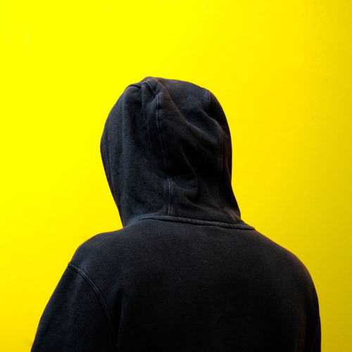 Rear View Of Man Against Yellow Background