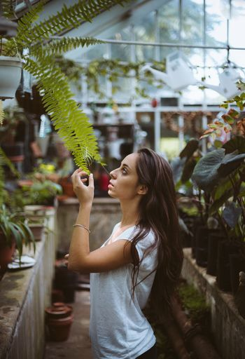 fern. One Woman Only Only Women One Person Waist Up Adults Only Greenhouse Choice Standing Plant One Young Woman Only Young Adult Beautiful Woman Indoors  People Adult Women Healthy Eating Tree Freshness Day
