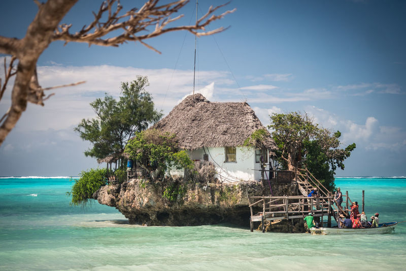 Water Sea Sky Tree Thatched Roof Nature Beach Land Day Beauty In Nature Roof Trip Holiday Scenics - Nature Hut Vacations Plant Cloud - Sky Tropical Climate Outdoors Horizon Over Water