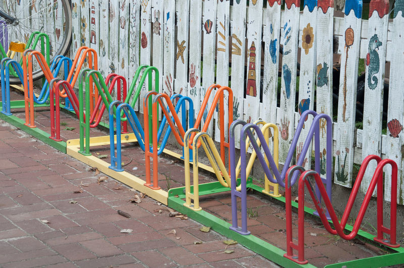 Bike Rack Colorful Day For Children Graffiti Large Group Of Objects Messy Multi Colored Multicolored No People Outdoors Vibrant Color Wall - Building Feature The Color Of School