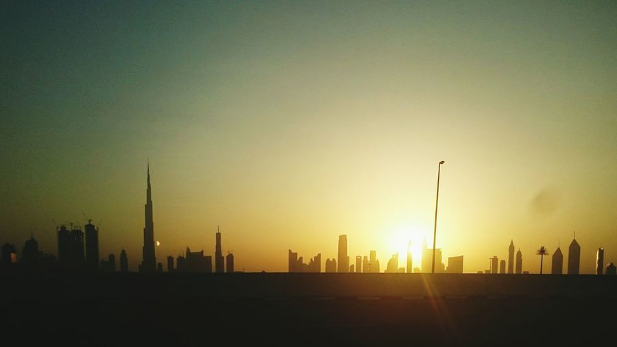 Sunset dubai 🌇 I Love Dubai♡ Burj Khalifa Uaegram EyeEm Best Shots Sunset_collection Sunset Silhouettes Hello World Check This Out Taking Photos Enjoying Life Hot Day Dessertstory Buildingphotography Mydubai Tallestbuilding Sunsetlove