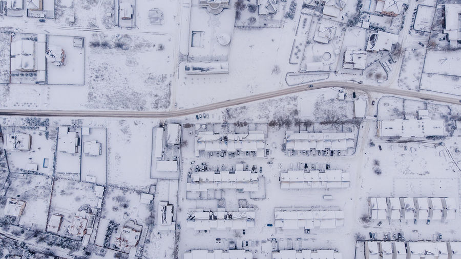 Aerial view on winter village. many houses.