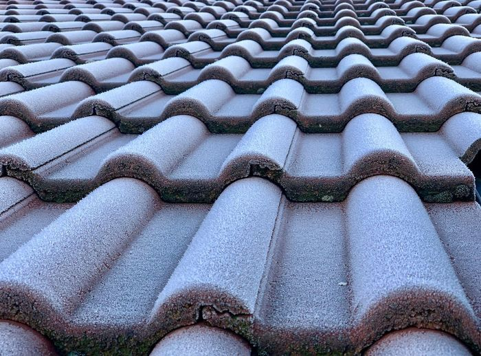Cold Temperature Ice Cold Days Roof Roof Tile Rooftop View  Full Frame Backgrounds Pattern No People High Angle View Day Nature Close-up Architecture Outdoors Built Structure Roof Building Textured  Sunlight Land Repetition Arrangement Building Exterior Roof Tile