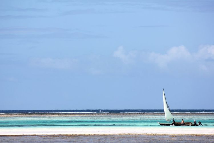 Sea Water Sky Land Horizon Beauty In Nature Beach Cloud - Sky Scenics - Nature Horizon Over Water Nature Day Mode Of Transportation Sailboat Transportation Nautical Vessel Idyllic Tranquil Scene Outdoors No People Turquoise Colored Zanzibar Tanzania Boat