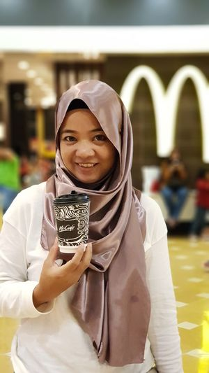 A malay girl pose in front of McDonald restaurant outlet while holding McCafe cupEyeEm Selects Looking At Camera Pose McDonald Malay McCafe Girl Adult Indoors  Portrait