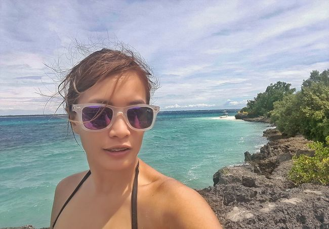 Salty hair, tanned skin and this view 💙 Vacations Sunglasses Looking At Camera Portrait Beach Mid Adult Headshot Close-up Leisure Activity Bikini One Person Relaxation One Woman Only Mature Adult Females Only Women People Adult Beauty Sand Ivyenturer IvyEntures2016 Enjoying Life Beachaholic Travelphotography
