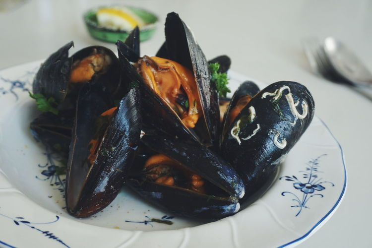 Close-up of mussels in plate on table