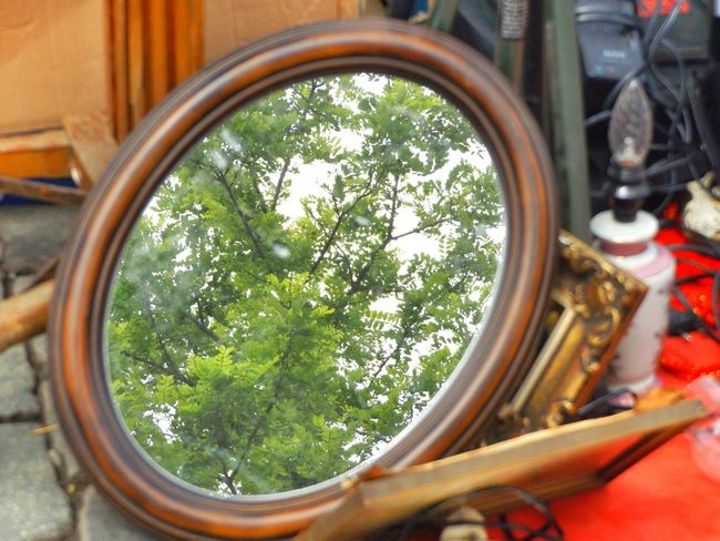 In the middle of treasure. Fleamarket Live Love Shop Items For Sale Streetphotography Mirror Items Mirror Reflection On The Floor Collectable Items Old But Gold Cobblestone Streets Collection Reflection Window Reflections Day Tree Outdoors Sky Historical Place Vintage Waterdrops Glitch