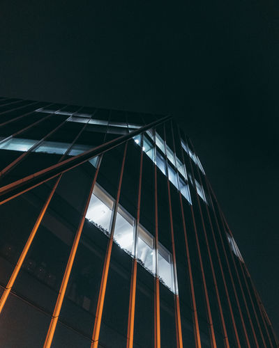 Low angle view of illuminated building against clear sky at night