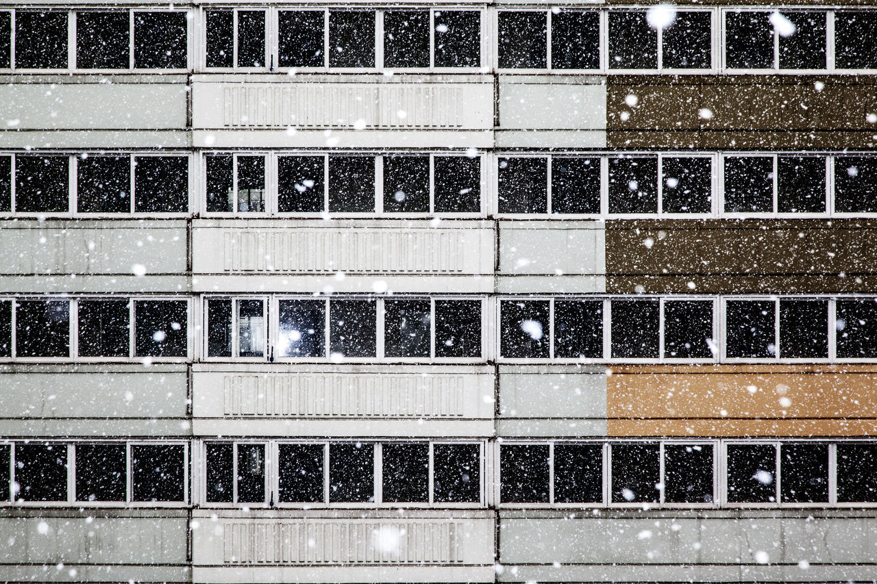 Full frame shot of building during snow fall