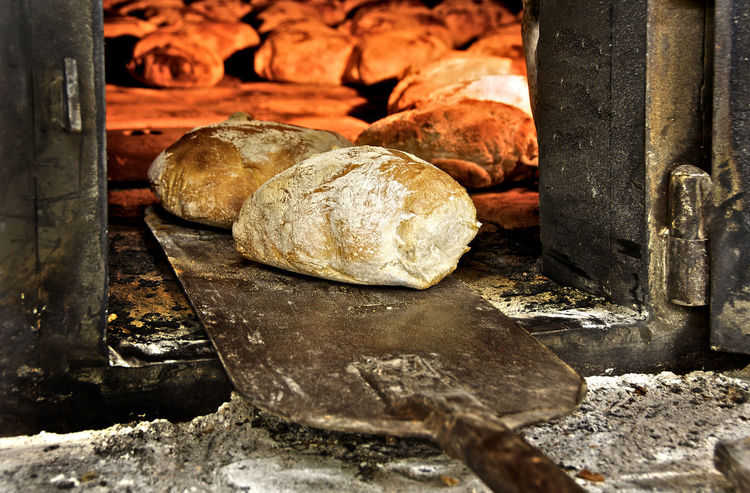 Bread freshly made in the oven Bakery Baking Bread Bread Close-up Day Dough Food Food And Drink Freshness Healthy Eating Heat - Temperature Indoors  Loaf Of Bread No People Oven Oven Preparation