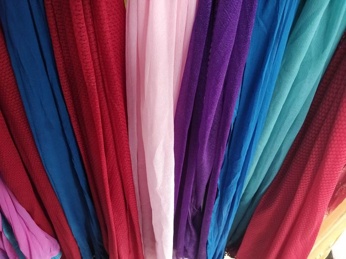 Multi Colored Textile Variation Choice Full Frame Store No People Backgrounds Retail  Clothing Shopping Industry Textile Industry Indoors  Hanging Large Group Of Objects Clothing Store Close-up For Sale Pattern Retail Display Consumerism Garment Boutique Clean