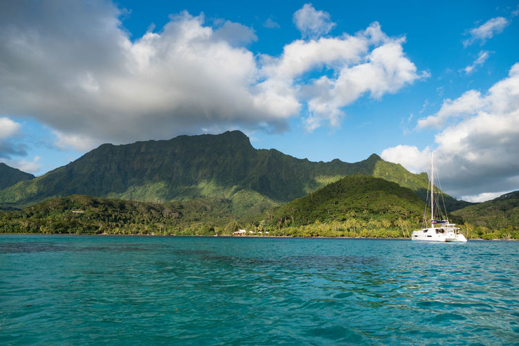 Catamaran Travel Photography At Anchor Beauty In Nature Cloud - Sky Day Mode Of Transport Mountain Nature Nautical Vessel No People Outdoors Scenics Sea Sky Tranquil Scene Tranquility Transportation Travel Destinations Tropical Island Water Waterfront